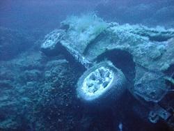 Car wreckage at Migrah Ferha Dive site