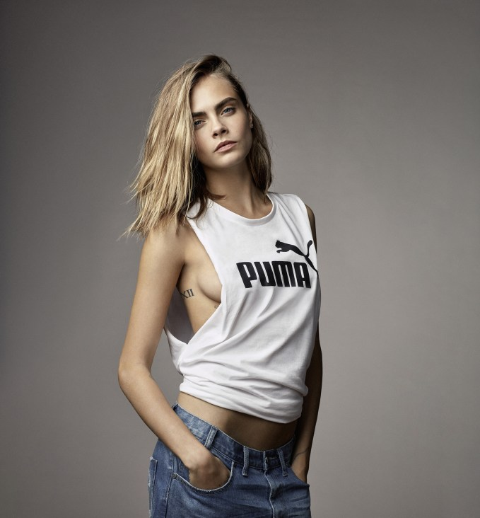 Cara Delevingne poses with big cat for Puma