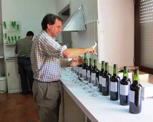 Charles opening the sample bottles whilst Paulo rinses the last few glasses