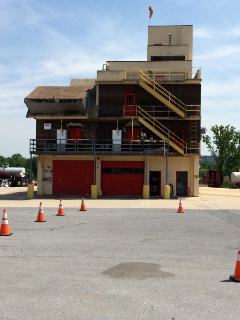 The central building block of the most complex operational training is the burn building. Inside, the space is sub-divided into props for several special training projects. The Buffalo floor collapse prop is inside grade level overhead doors.