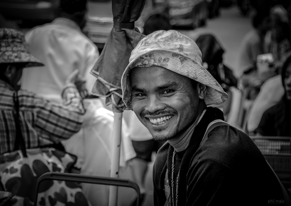 Street portrait of a thai fisherman smiling at the camera