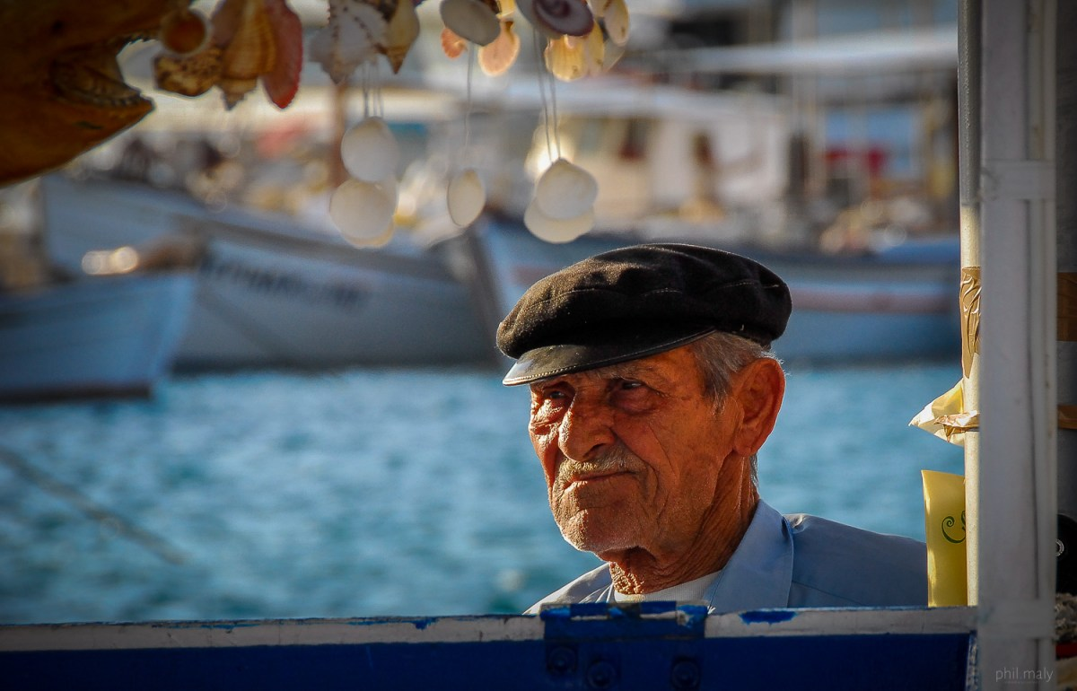 Portrait of an old fisherman in the harbour of Paros