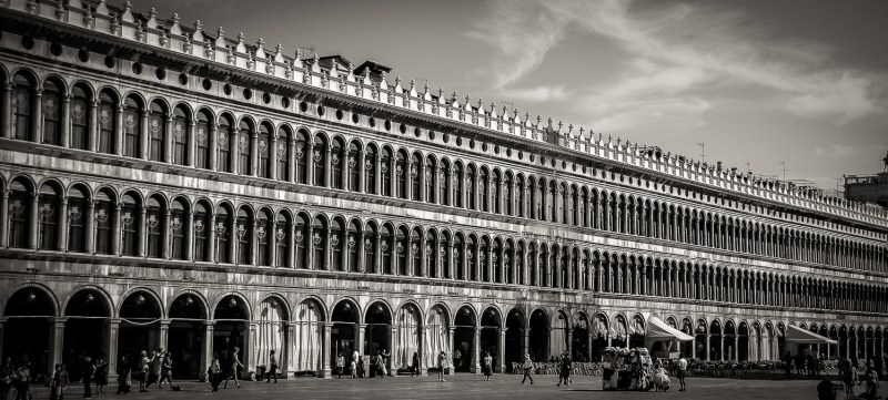 The many windows of the facade of the palace on the Piazza San Marco