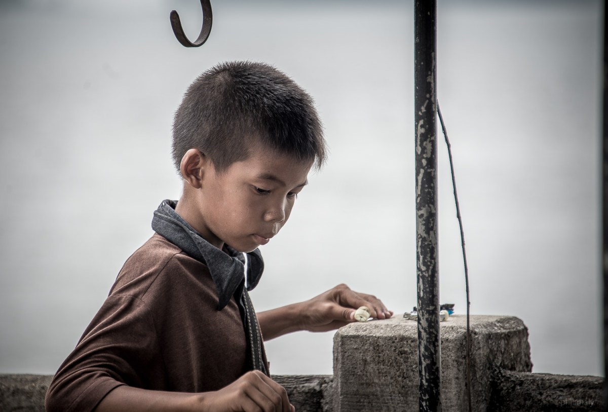 Portrait of a little thai boy playing