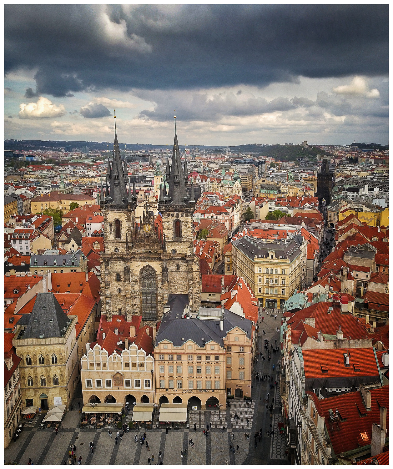 Drone shot of the gothic church of Tyn on the old town square of Prag