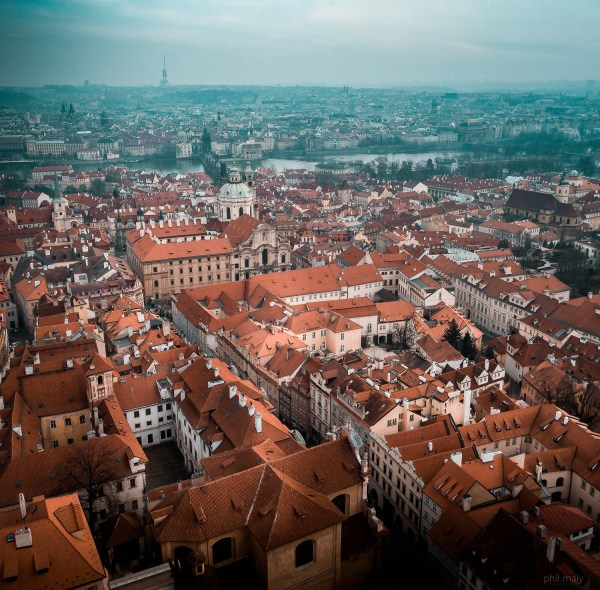 Drone shot over the rooftops of Mala Strana neighborhood in Prag