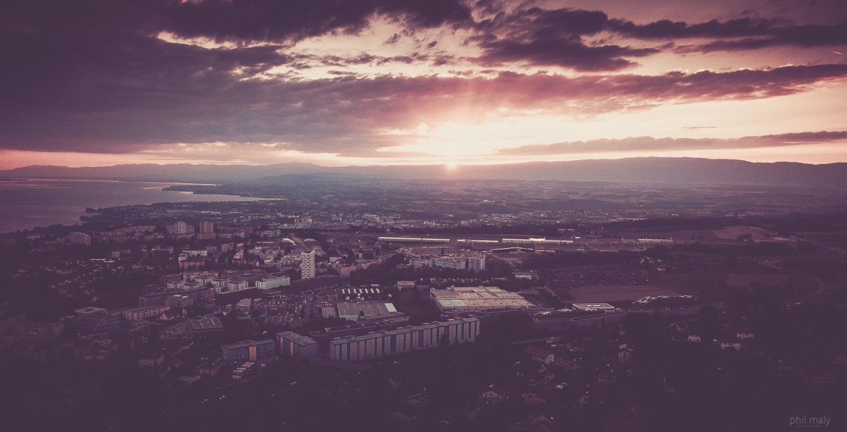 Drone shot of a sunset over Lausanne and the lake Leman