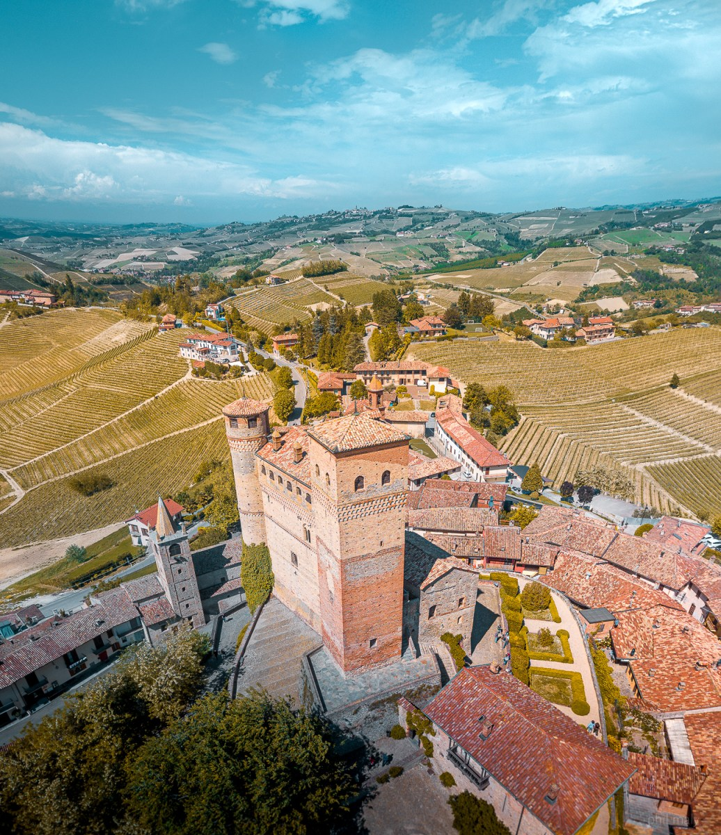 Drone shot of the Castello di Serralunga d'Alba with its red brick