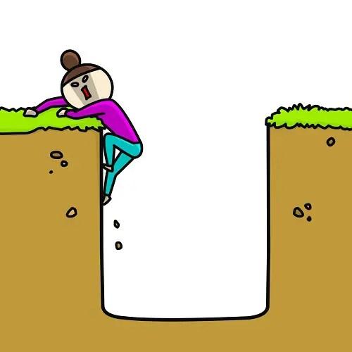 落とし穴から這い上がる人