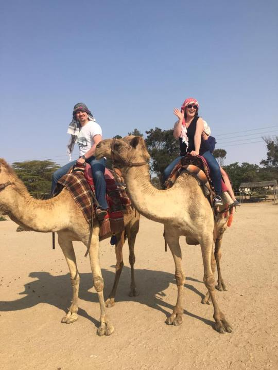 camel ride in the desert moment