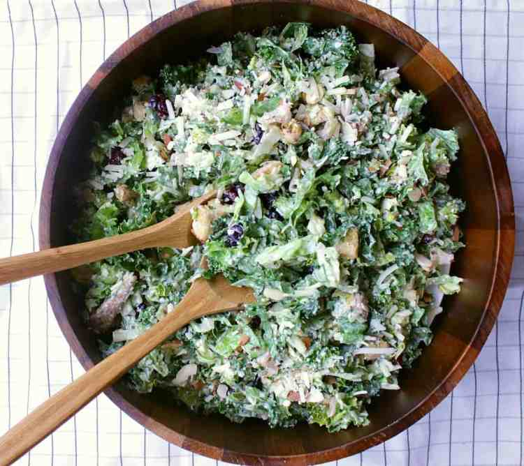 Kale Caesar Salad. Crisp kale, toasted almonds and cranberries, this fully loaded bowl of happiness will be your favourite side kick from here on out.