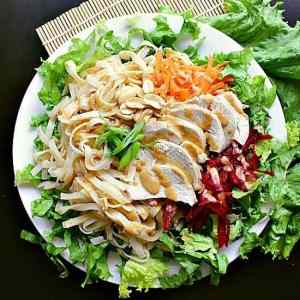 Moist chicken, shredded beets and carrots, all tossed together with rice sticks, salted peanuts and green onion, smothered in a delicious peanut dressing.