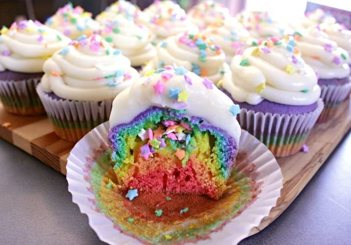Rainbow Cupcakes with Cream Cheese Icing. Super fun and delicious rainbow cupcakes with a perfect cream cheese icing are great for birthdays and baby showers!
