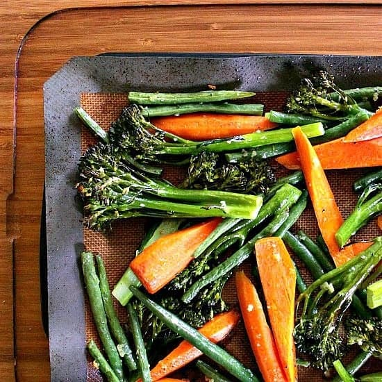 Garlicky Roasted Vegetables. These roasted vegetables are packed with flavour and carry the perfect texture. Crisp broccolini, vibrant carrots, crunchy green beans and roasted garlic play together beautifully to create an epic side dish that knows no bounds.