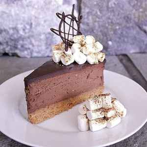 S'mores Cheesecake. Bring in the summer with this s'mores cheesecake! Graham crumb crust, chocolate cheesecake with ganache topping, finished off with toasted marshmallows.