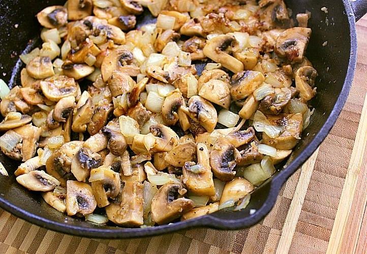 Skillet full of browned mushrooms.