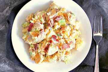 This delicious Yam and Red Potato Salad is drenched in a creamy vinaigrette and packed with crispy bacon!