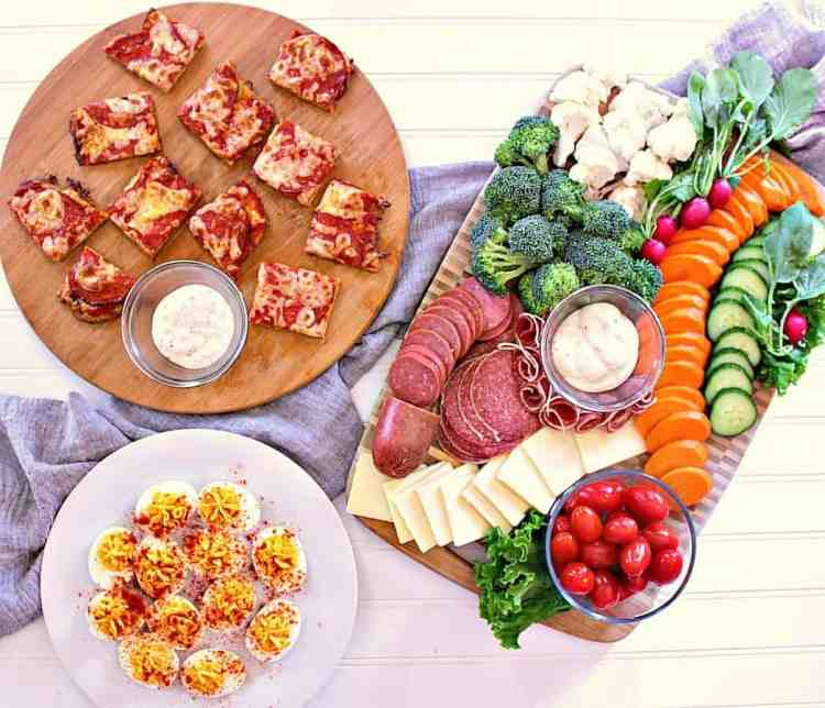Appetizer night! Veggie board with ranch, cheese and meats. Devilled eggs and a platter of low carb pizza bites.