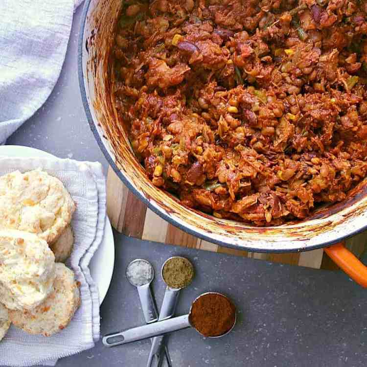 Pot of leftover turkey chili next to some cheese biscuits.