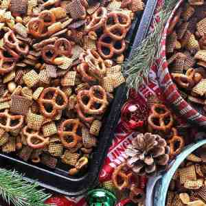 This crunchy, salty, perfectly spiced Addicting Christmas Chex Mix is a great snack for the Christmas season or to make for easy and yummy gifts.