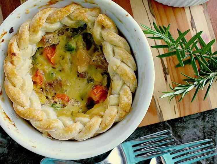 Single turkey pot pie with a ring of braided turkey around the top.