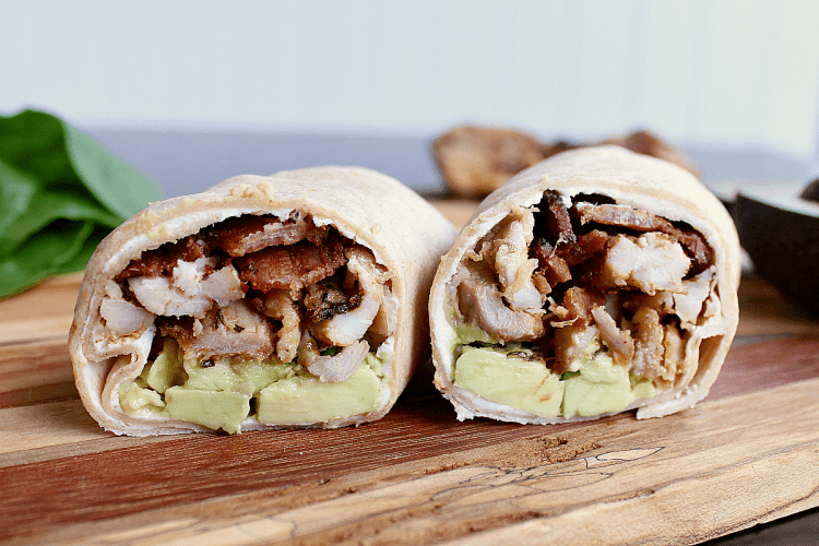 low carb chicken wrap cut in half to display inside yumminess.