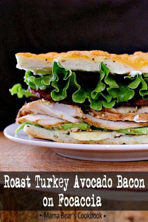 This Roast Turkey Avocado Bacon on Focaccia is a fully loaded focaccia sandwich jam packed with roast turkey, avocado, crisp bacon and aged cheddar. #sandwich #panini #turkey #focaccia #mamabearscookbook
