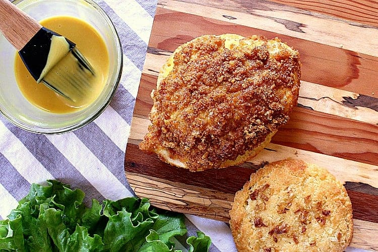Crispy Keto Chicken Burger on a low carb onion bun with keto honey mustard.