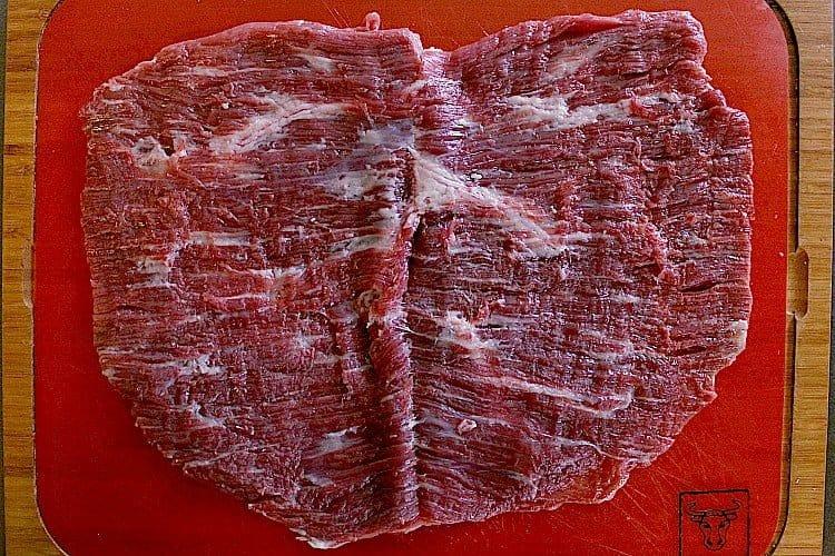 flank steak cut in half, horizontally, and opened like a book.
