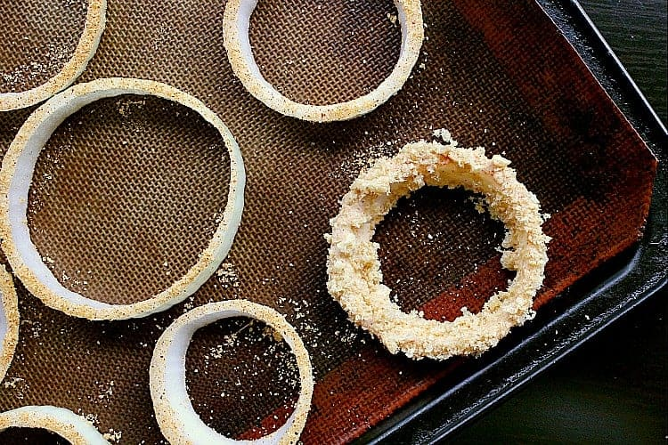 onion ring fully coated and placed back on the baking sheet.