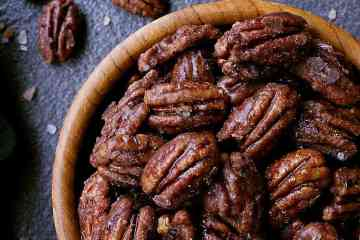 Bowl of sugar free candied pecans.