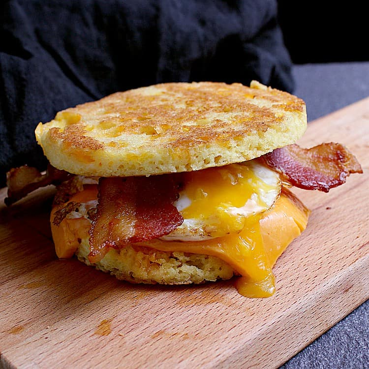 Keto breakfast sandwich on a 90 Second Keto Bread with an egg, cheddar and bacon.