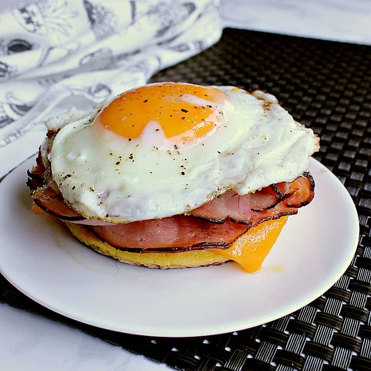 keto breakfast sandwich with an egg, ham and cheddar.