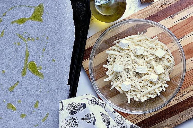 Bowl of mozzarella, almond flour and cream cheese cubes.