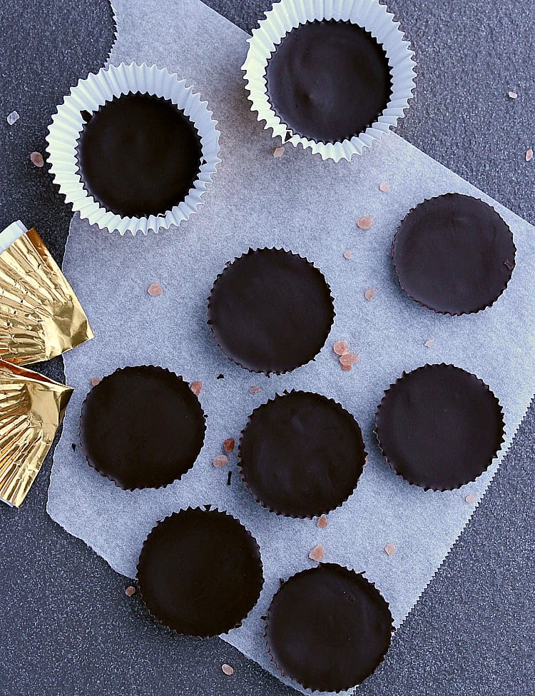 Seven Keto Peanut Butter Cups with the paper liners removed, two still in their liners.