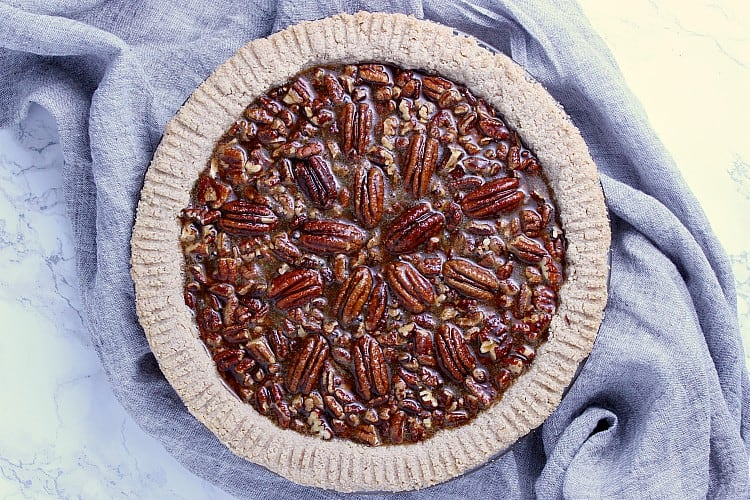 Pie crust filled with pecans and filling.
