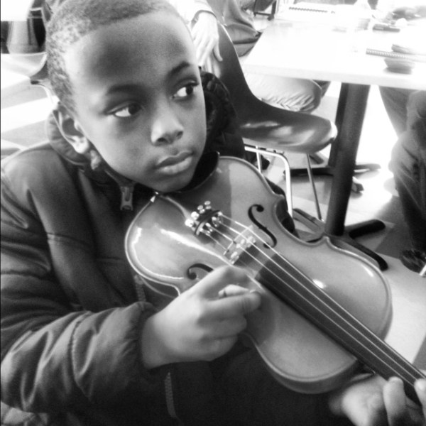 Holding his new violin!