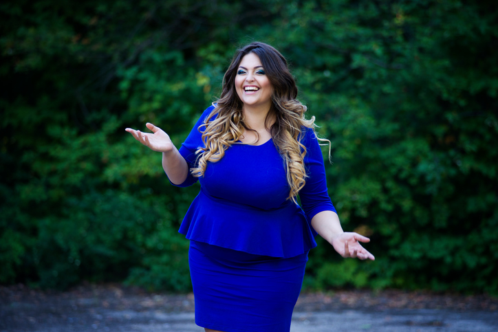 Young happy smiling beautiful plus size model, xxl woman