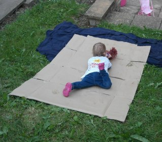 Divebombing down the cardboard slide!