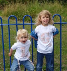 The girls in in their two little peas and me t shirt