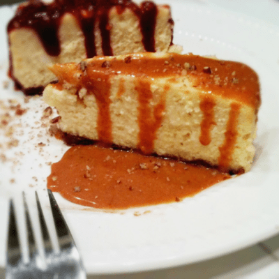 Cheesecake with strawberry or butterscotch sauce