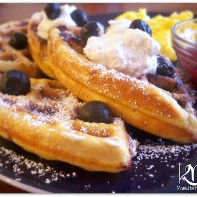 Fluffy Golden Blueberry Waffles with Whipped Cream