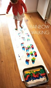 Rainbow walking, an artistic fun way for sensory play and foot print art