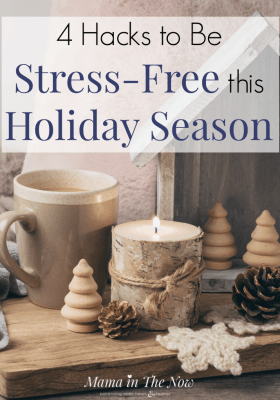 Christmas hygge with a candle and hot cup of cocoa