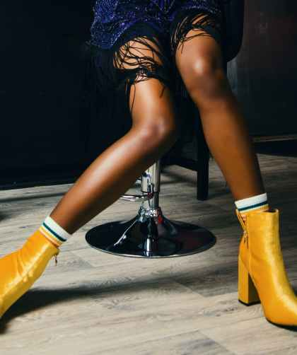photo of person wearing yellow boots