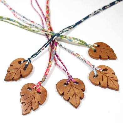 LEAFS 4 1 - Palm leaf pendant apple wood teething necklace on pink Liberty cord