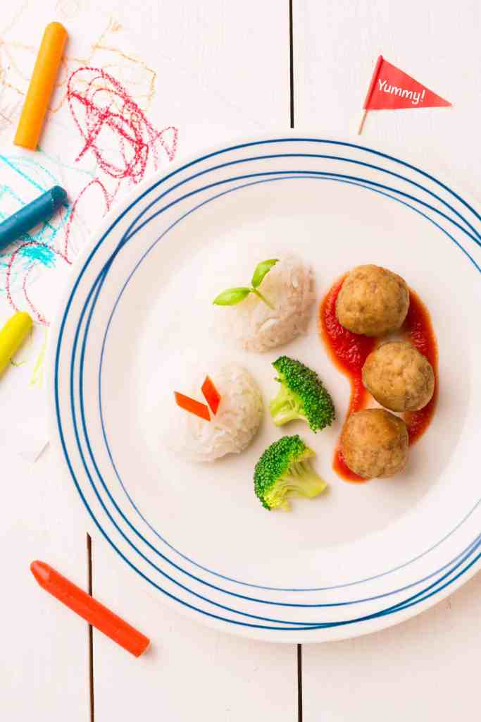 kids plate with meatballs, rice, and broccoli