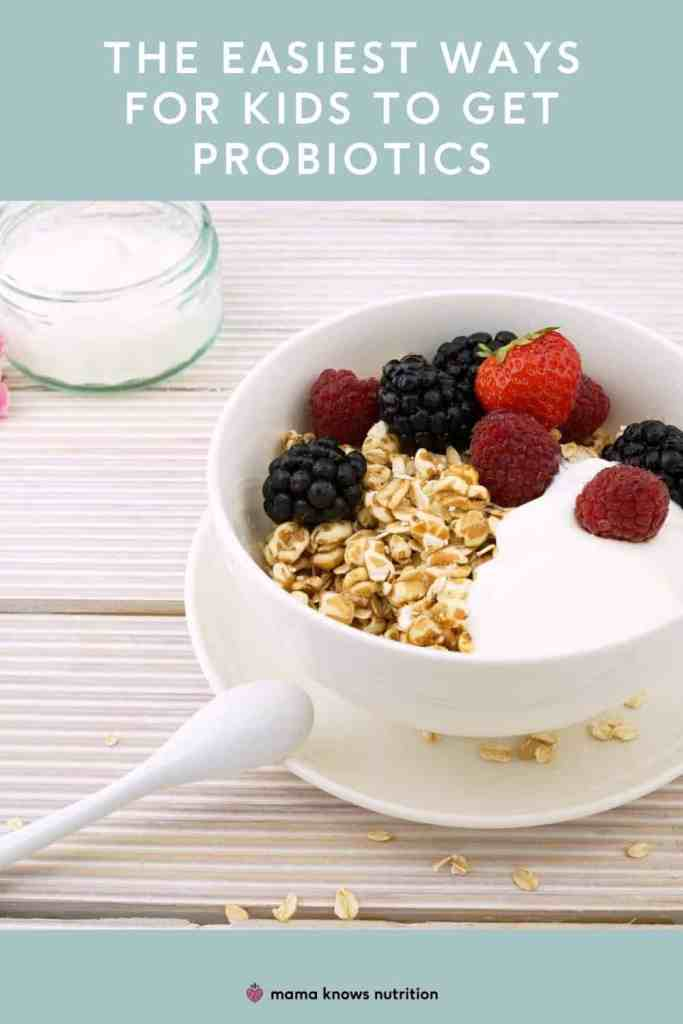 yogurt in a white bowl with berries and granola