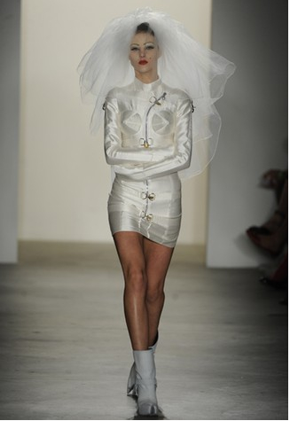 Fashion runway bride, with bridal straightjacket.