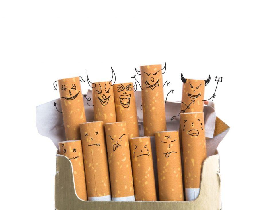 Cigarros con caras malévolas dibujadas en los filtros